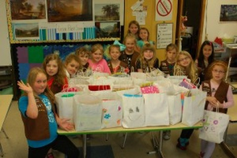 Manor Brownie Troop makes Summer Fun Packs