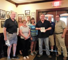 Flaherty receives plaque from HF-M Kiwanis