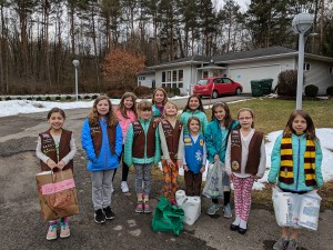 Brownie Troop 60381 of Honeoye Falls encourages visitors to Pet Pride Cat shelter in Victor