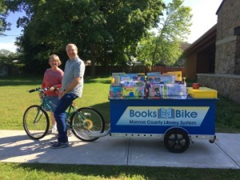 "Monroe County Library System's ""Books by Bike"" to be at Mendon Fire Department Carnival"