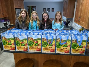 HF-L Girl Scouts Make  'dinner in a bag'  for Children Awaiting Parents