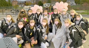 HF-L girls soccer team helps local resident