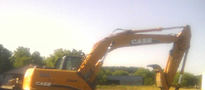 Construction equipment has appeared at the future site of a Dunkin' Donuts in Honeoye Falls. photo by Donna MacKenzie