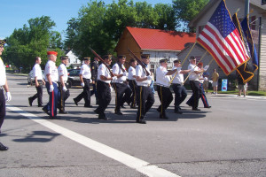 Members of the Honeoye Falls American Legion Post #664 make the turn onto Route 64 en route to the Mendon Cemetery during the Memorial Day parade. Photo by Donna MacKenzie