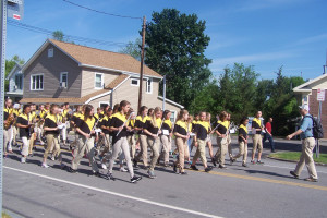 The  members of the Honeoye Falls-Lima Middle School band march during the Memorial Day parade in Mendon. Photo by Donna MacKenzie